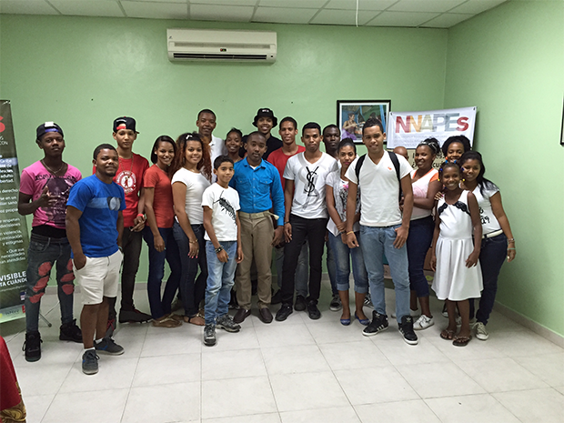 Kharon and the group of youth community leaders with whom he shared his story. Photo: Luciano Cadoni / CWS