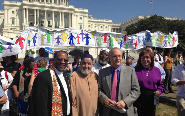 Rev. McCullough, Imam Jarr-Korama, Rabbi Saperstein, Bishop Carcano at an immigration reform rally in Washington, D.C. Photo: Noel Andersen/CWS
