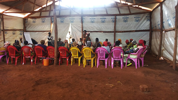 Refugee women in Nyarugusu Refugee Camp in Tanzania participate in the CWS program. Photo: Davide Prata / CWS